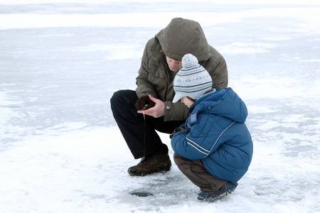 ice fishing: winter fishing family leisure outdoor