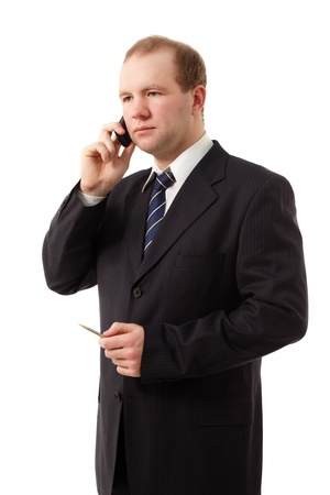 smiing: young businessman speaking mobile phone isolated on white background Stock Photo