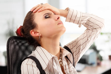 stressed people: business woman tired depressed in office