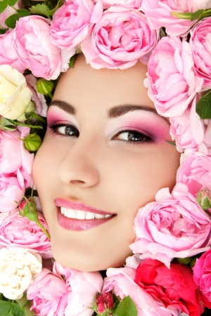 beauty portrait of beautiful young female face with flower roses frame photo