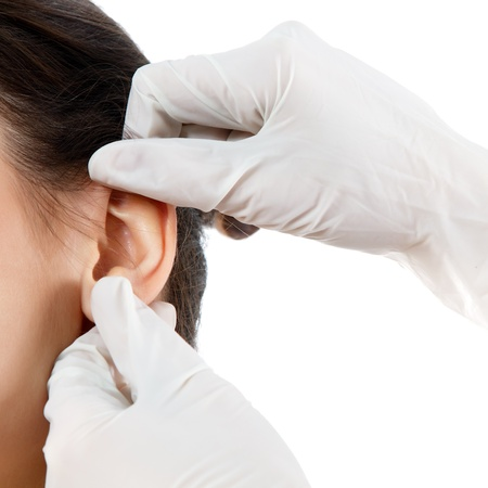 plastic glove: young woman face with beauty treatment ear plastic isolated Stock Photo