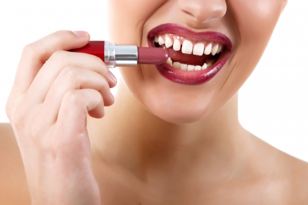 funny portrait of young beautiful woman with lipstick make grimace and show teeth isolated on white background photo