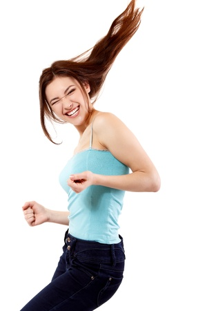 Winning teen girl happy ecstatic gesturing success. Isolated on white background. photo