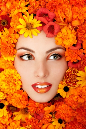 beauty portrait of beautiful female face with orange flowers frame Stock Photo - 14731858