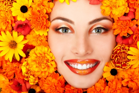 beauty portrait of beautiful female face with orange flowers frame  photo