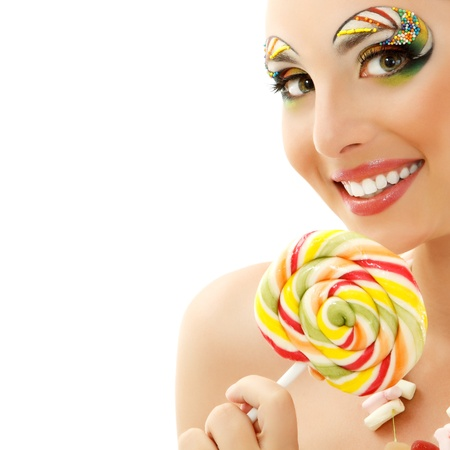 woman licks candy with beautiful make-up isolated on white background photo