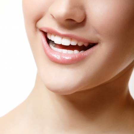 Smile of beautiful woman with great healthy white teeth. Isolated over white background  photo