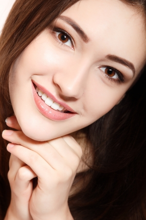 emotion faces: teen girl beauty face happy smiling and looking at camera isolated on white background Stock Photo