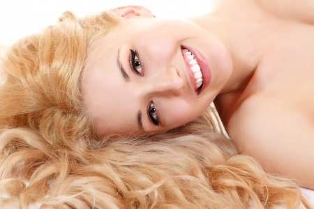 Beautiful long blond healt curly hair of young attractive woman. Isolated on white background Stock Photo - 14695443