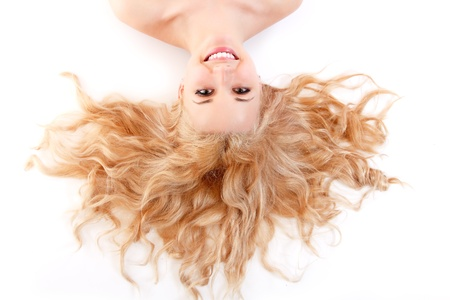 beautiful long blond healt curly hair of young attractive woman. isolated on white background Stock Photo - 14695452