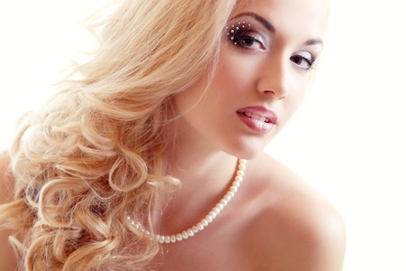 beauty portrait of young woman bride with beautiful makeup and and long blond hair over white background Stock Photo - 14695501