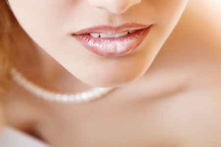 Closeup female lips. Isolated over white background  Stock Photo - 14695468