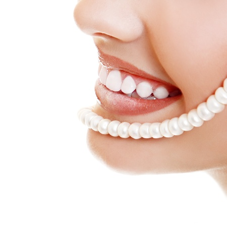 Beautiful smile of young fresh woman with great healthy white teeth and perls. Isolated over white background Stock Photo - 14695398
