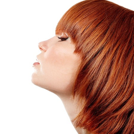 profile of young beautiful redheaded teen girl. isolated on white background. photo