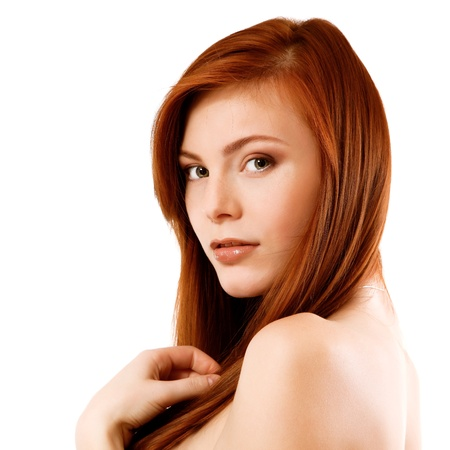 Beautiful long red healt hair of young attractive woman. Isolated on white background photo