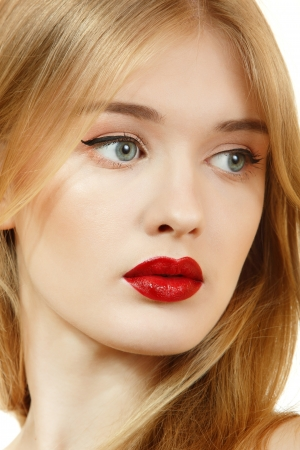 Beautiful woman face closeup with long blond hair and vivid red lipstick photo