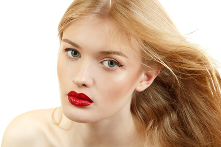Beautiful woman face closeup with long blond flying hair and vivid red lipstick. Isolated on white background photo
