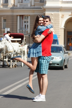 Love story of young couple hug in summer city photo