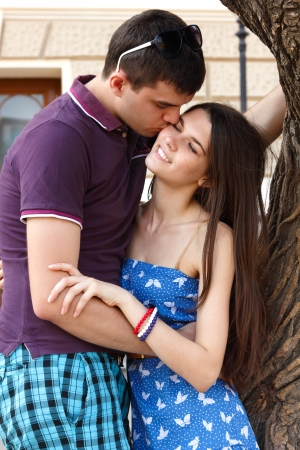young couple hugs over summer nature outdoor Stock Photo - 14795692