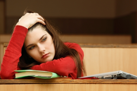 student teen girl beautifyl tired in empty classroom university Stock Photo - 15153793