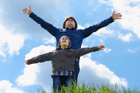 happy father with little son enjoying life over blue sky photo