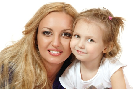 a tooth are beautiful: Portrait of happy mother with liitle daughter. White background