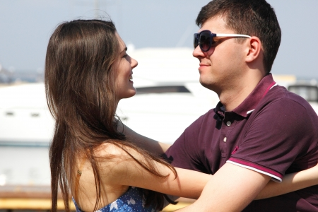 young beautiful caucasian couple hugs in yacht club photo