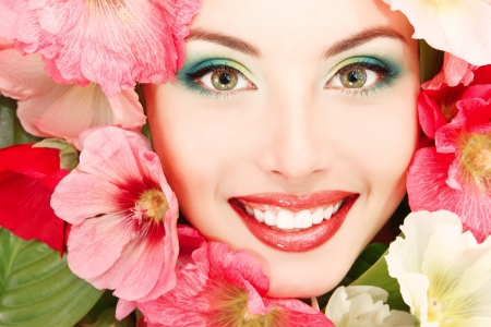 beauty summer portrait of beautiful female face with pink, red and white mallow flowers frame  Stock Photo