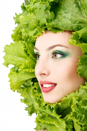 woman beauty face with green fresh lettuce leaves frame photo