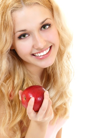 Young happy healthy woman with fresh ripe red apple, isolated on white background photo