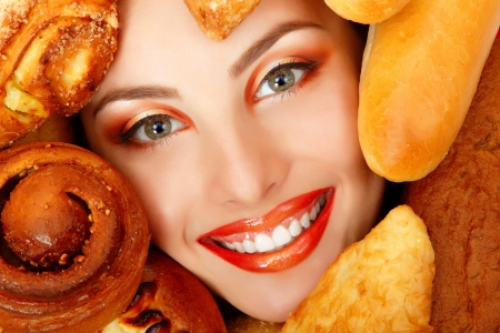 woman beauty face with bread bun patty baking food frame photo