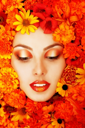 beauty portrait of beautiful female face with orange flowers frame