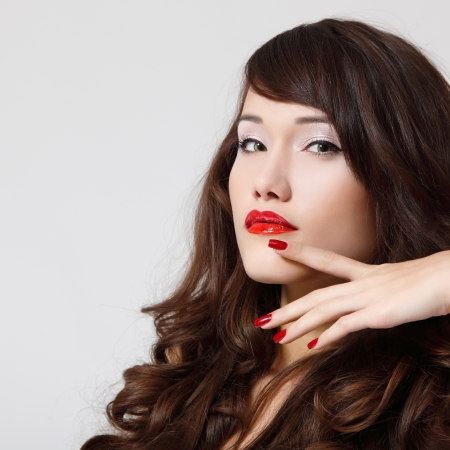 young beautiful woman with pefect long hair and vivid red lipstick photo