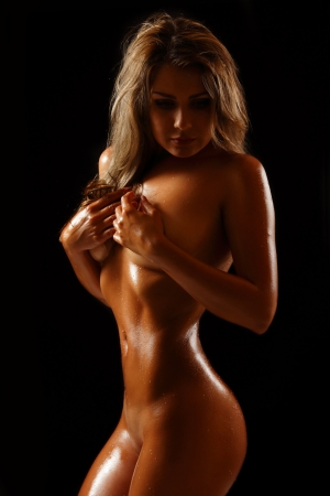 sexy nude girl: perfect tan slim body of sexy nude young woman, studio shot