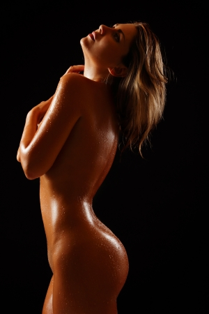 naked woman back: perfect tan slim body of sexy nude young woman, studio shot
