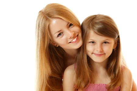 young schoolgirl: portrait of two sisters happy smiling (child and teen), isolated on white background Stock Photo