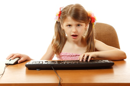 dependence: child with internet dependence with keyboard looking at camera like in monitor, girl 8 year old, isolated on white Stock Photo