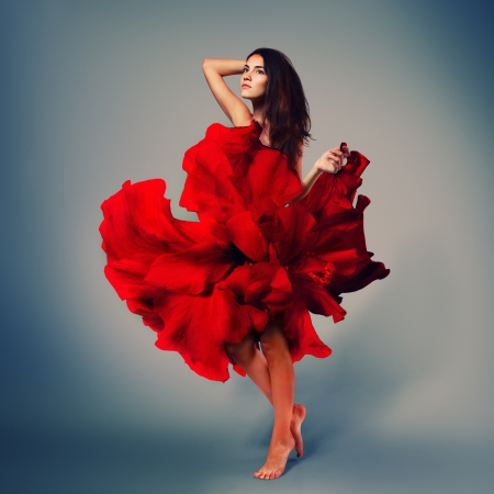beautiful romantic girl in red flower dress with long broun hair barefoot, full length studio portrait photo