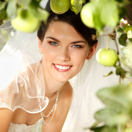 beautiful bride in apple tree garden, summer outdoor photo