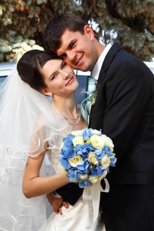 beautiful young bride hugs groom in love outdoor