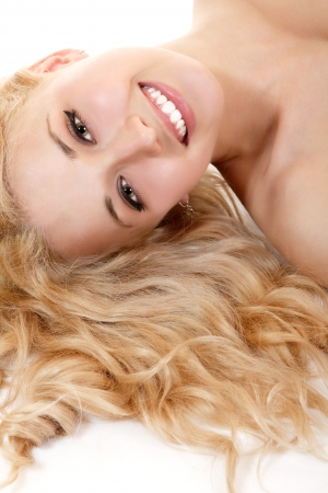 beautiful long blond healt curly hair of young attractive woman. isolated on white background photo