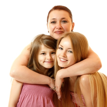 teenage love: happy mother hugs daughters, isolated on white background