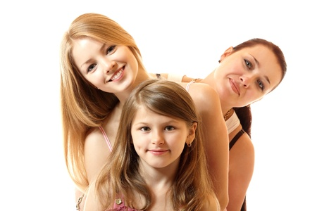 three generations: happy mother with two daughters, isolated on white background