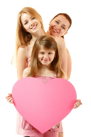 happy mother with two daughters holding big heart, isolated on white background
