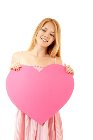 sudio: happy girl with big pink heart, isolated on white background