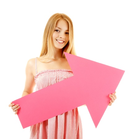 sudio: happy girl holding pink arrow, isolated on white background Stock Photo