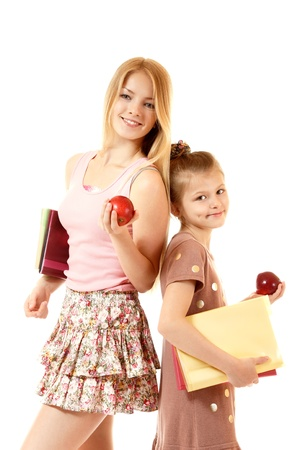 two education girls with books and apples, isolated on white background photo
