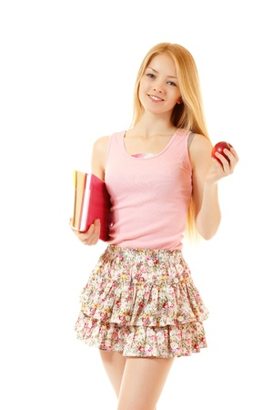 sudio: happy attractive student girl with books and apple, isolated on white background