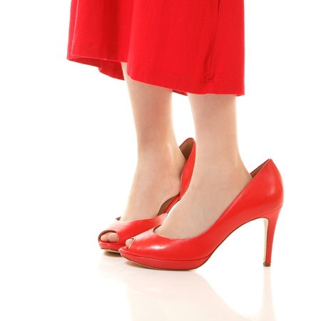 little fashion girl in mothers red dress and shoes on high heels, isolated on white background photo