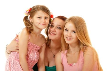 jeune fille adolescente: heureuse m�re de deux filles, isol� sur fond blanc Banque d'images